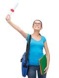 Estudiante sonriente con el bolso y las carpetas Imágenes de archivo libres de regalías
