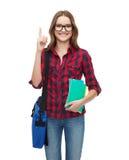 Estudiante sonriente con el bolso y los cuadernos Fotos de archivo