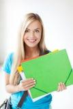 Estudiante sonriente con las carpetas Imágenes de archivo libres de regalías