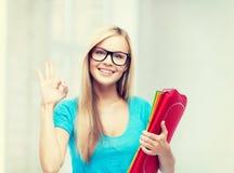 Estudiante sonriente con las carpetas Fotografía de archivo