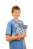 Estudiante sonriente con los libros coloridos Imagenes de archivo