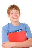 Estudiante sonriente con los libros coloridos Imágenes de archivo libres de regalías