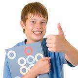 Estudiante sonriente con los libros coloridos Imagen de archivo libre de regalías