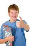 Estudiante sonriente con los libros coloridos Foto de archivo