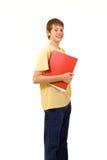 Estudiante sonriente con los libros coloridos Fotografía de archivo libre de regalías