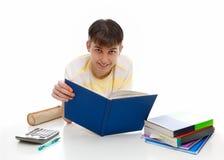 Estudiante sonriente con los libros de textos Imagen de archivo libre de regalías