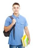 Estudiante sonriente con los libros y la mochila Foto de archivo