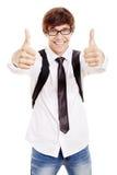 Estudiante sonriente con los pulgares para arriba Fotografía de archivo libre de regalías