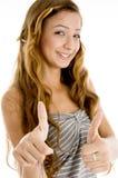 Estudiante sonriente del adolescente con los pulgares para arriba Imagen de archivo
