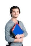 Estudiante sonriente feliz con las notas Imagen de archivo libre de regalías