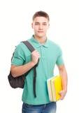 Estudiante sonriente feliz con los libros y la mochila Imagenes de archivo