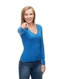 Estudiante sonriente que señala el finger en usted Fotografía de archivo