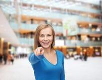 Estudiante sonriente que señala el finger en usted Imagenes de archivo