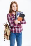 Estudiante sonriente que se coloca con el libro Imágenes de archivo libres de regalías