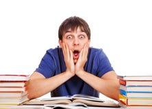 Estudiante sorprendido con libros Imagen de archivo
