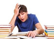 Estudiante sorprendido con libros Fotos de archivo