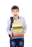 Estudiante sorprendido con libros Imágenes de archivo libres de regalías