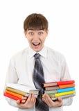 Estudiante sorprendido con muchos libros Fotografía de archivo libre de regalías