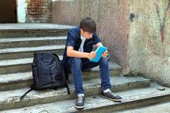 Estudiante triste con el libro Foto de archivo libre de regalías