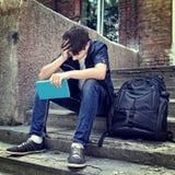 Estudiante triste con el libro Fotografía de archivo libre de regalías