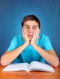 Estudiante triste con el libro Imagenes de archivo