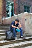 Estudiante triste con el libro al aire libre Fotografía de archivo libre de regalías
