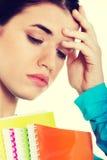Estudiante triste con el libro de trabajo Foto de archivo libre de regalías