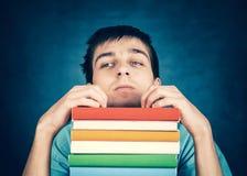 Estudiante triste con libros Fotografía de archivo libre de regalías