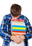 Estudiante triste con libros Imágenes de archivo libres de regalías