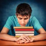 Estudiante triste con libros Imagen de archivo libre de regalías