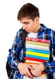 Estudiante triste con los libros Fotografía de archivo