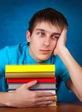 Estudiante triste con los libros Fotos de archivo
