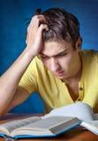 Estudiante triste con un libro Fotografía de archivo libre de regalías