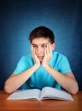 Estudiante triste con un libro Imagenes de archivo