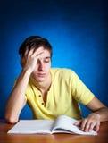 Estudiante triste con un libro Imagen de archivo libre de regalías