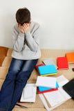 Estudiante triste en casa Imagen de archivo libre de regalías