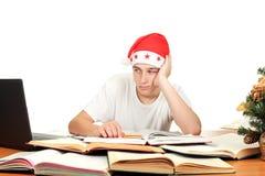 Estudiante triste en el sombrero de santa Fotografía de archivo libre de regalías