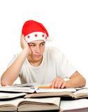 Estudiante triste en el sombrero de santa Imagenes de archivo