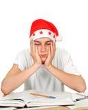 Estudiante triste en el sombrero de santa Foto de archivo