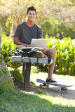 Estudiante un parque Imagen de archivo