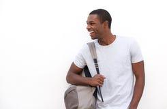 Estudiante universitario afroamericano feliz con el bolso Imagen de archivo libre de regalías