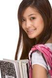 Estudiante universitario asiático con el morral y los cuadernos Fotos de archivo libres de regalías