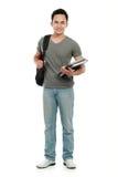 Estudiante universitario con el libro y el bolso Imagen de archivo