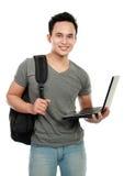 Estudiante universitario con la computadora portátil Imagen de archivo libre de regalías