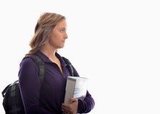 Estudiante universitario con la mochila y los libros Fotos de archivo libres de regalías