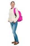 Estudiante universitario en el desgaste del invierno que presenta con la mochila rosada Imagen de archivo