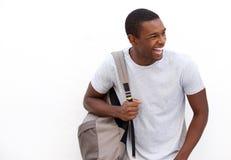 Estudiante universitario que ríe con el bolso Fotos de archivo