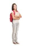 Estudiante universitario que se coloca en el fondo blanco Fotografía de archivo