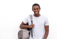 Estudiante universitario que sonríe con el bolso Foto de archivo libre de regalías