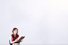 Estudiante y libro con el espacio de la copia Fotografía de archivo libre de regalías